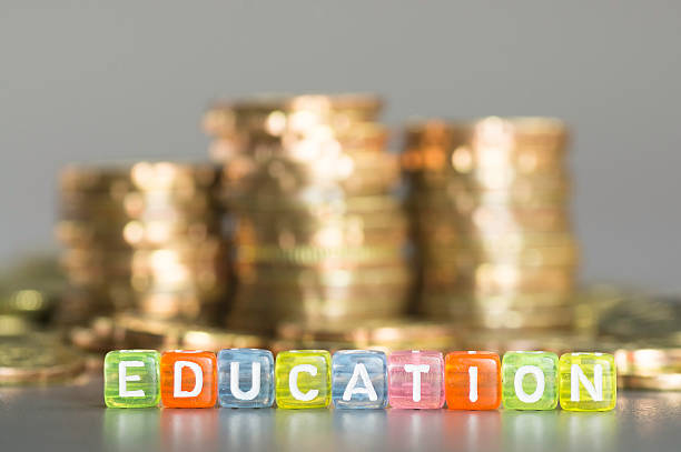 Education text and coins stock photo