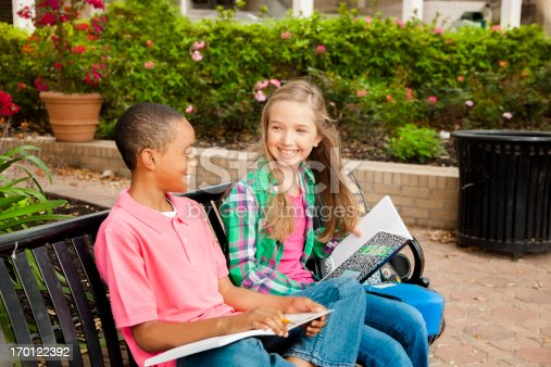 istock Education: Two elementary students waiting on a bench. 170122392