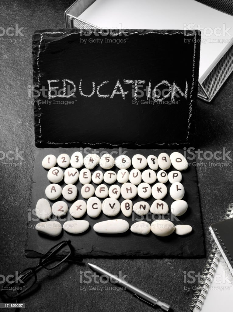 Education Written in Chalk on a Slate Laptop Computer royalty-free stock photo