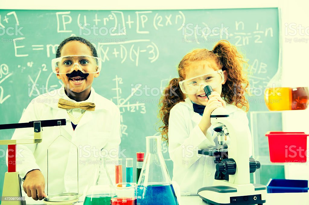 Education:  Young 'nerd' scientists in their lab doing experiments. stock photo