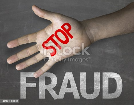 Educational and Creative composition with the message Stop Fraud on the blackboard