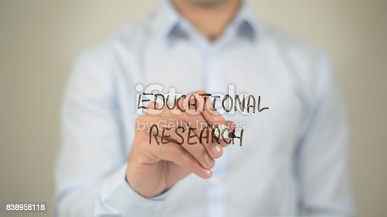 istock Educational Research , man writing on transparent screen 838958118