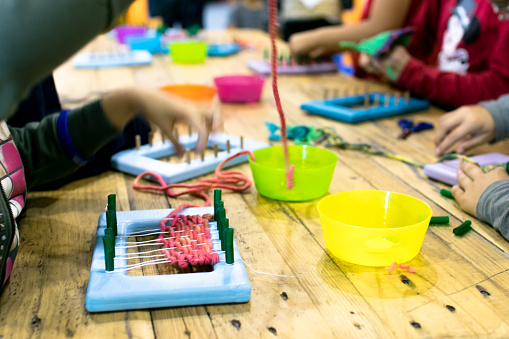 Educational weaving and knitting activity.