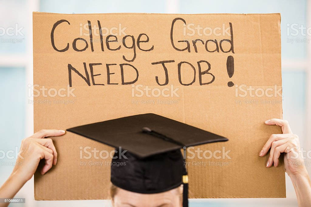 Educaton: College student holds 'College Grad Need Job' sign. stock photo
