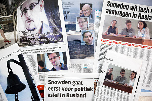 Edward Snowden # 1 XXXL Amsterdam, the Netherlands - July 22, 2013: A collection newspapers with pictures and publications of Edward Snowden (29) an American contractor for the US National Security Agency and former employee of the CIA. Snowden leaked details of several top-secret NSA documents to the English newspaper The Guardian. In June 2013 several publications in The Guardian reported that the US have been spying on domestic and international communications at internet and telephone. Snowden is responsible for one of the most significant leaks in US political history. On May 20, Snowden boarded a flight to Hong Kong and from there he leaked the information and then he fled to Moscow. The US pressing criminal charges against him, that could lead to extradition. Snowden's temporary asylum request is still undecided and he is to remain in Moscow Sheremetyevo airport's transit zone. Snowden is uncertain for the future, the circumstances make it hard for the NSA whistleblower to leave the Moscow airport. 2013 stock pictures, royalty-free photos & images