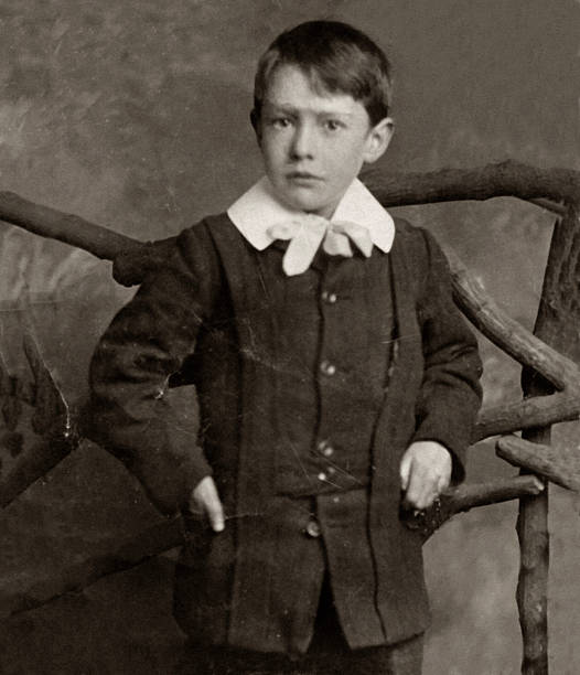 Edwardian Boy Antique photograph of a young boy from the Edwardian / Victorian period. antecedence stock pictures, royalty-free photos & images