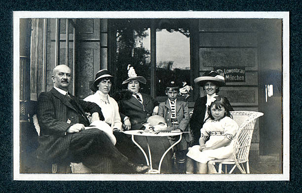 """Edwardian Family at Cafe - Vintage Photograph """"Vintage photograph of an Edwardian family on a day out at a cafe. Knokke, Belgium."""" edwardian style stock pictures, royalty-free photos & images"""