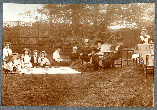Edwardian Picnic Vintage photograph of a group of edwardians having a picnic. Circ 1900 to 1910. edwardian style stock pictures, royalty-free photos & images