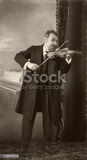 istock Edwardian style.The Violinist 175502075