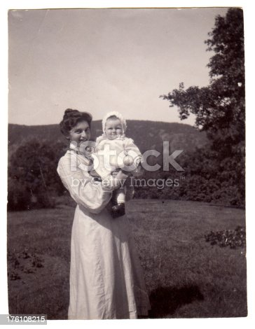 Vintage photograph of a young mother with her baby from the late Victorian early Edwardian period.