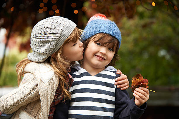 eeeuwww gross! - little girls little boys kissing love stock photos and pictures