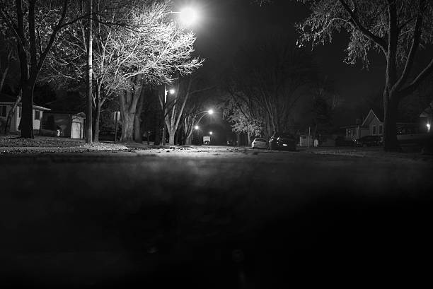 Eerie night on suburban street stock photo