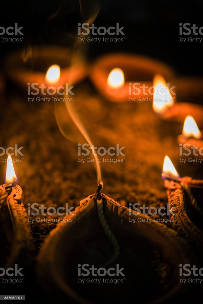 GST effect in India on diwali - diya or oil lamps became costly, oil lamp being extinguished because of lack of oil in diwali festival because of high price stock photo