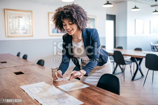 Smiling woman with cellphone in the office
