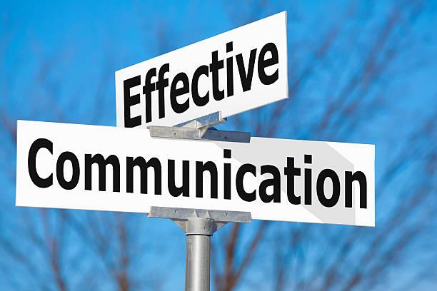 Effective Communication Street Sign stock photo
