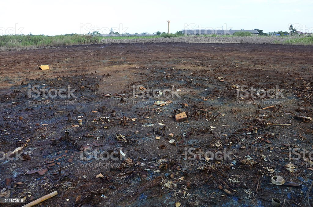 Effects of chemicals and heavy metals in soil from Industrial stock photo