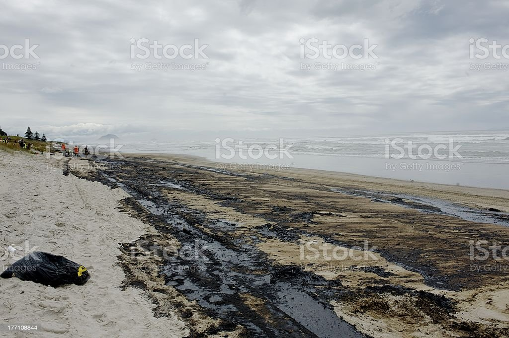 Effects of Rena oil spill on the beach Environemtal disaster: oil covers Papamoa beach in New Zealand. Accidents and Disasters Stock Photo