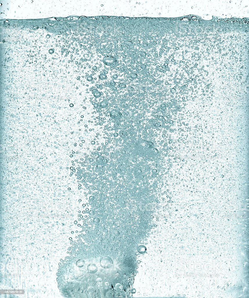 effervescent dissolving fizzy tablet in water stock photo