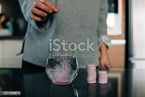 Effervescent tablets in water on the table