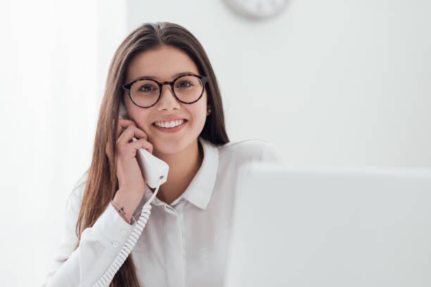 Efficient secretary on the phone stock photo