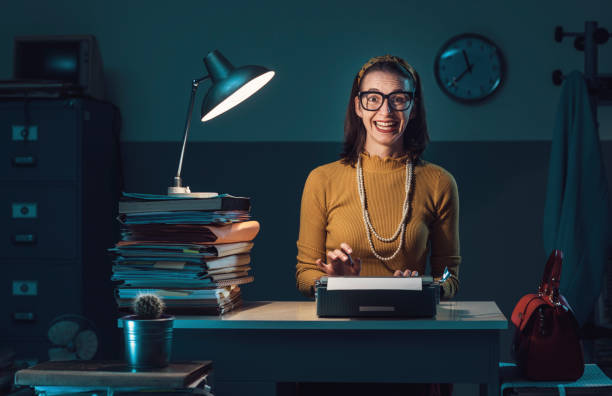 Efficient secretary working with a typewriter stock photo