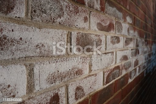 Maidenhead, England - February 23, 2019: a white, salty, crystalline deposit known as efflorescence can appear on masonry walls.  Whilst it doesn't affect a building structurally, it does have an impact on its appearance.  There are a number of reasons for its cause.