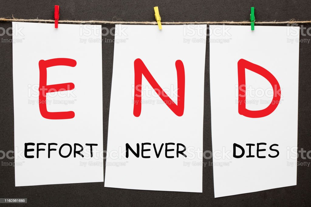 Effort Never Dies written on set stickers with clip hanging on a rope...