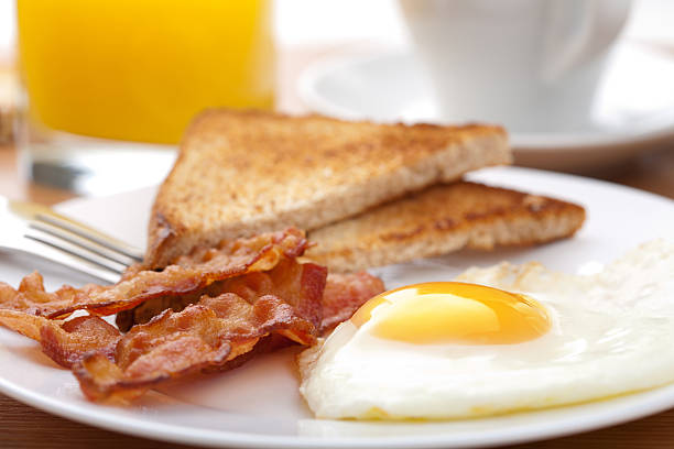 egg and bacon with toast - fried egg stock photos and pictures