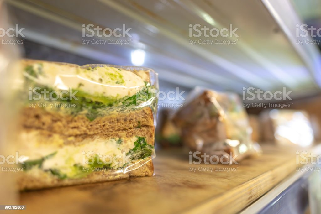 Egg and cress sandwich on a shelf in plastic wrap stock photo