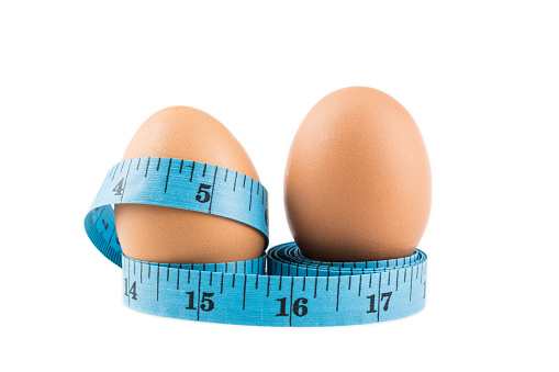 istock Egg and tape measure use for healthy diet concept 532332292