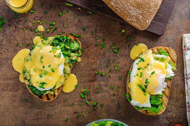 Egg benedict with spinach stock photo