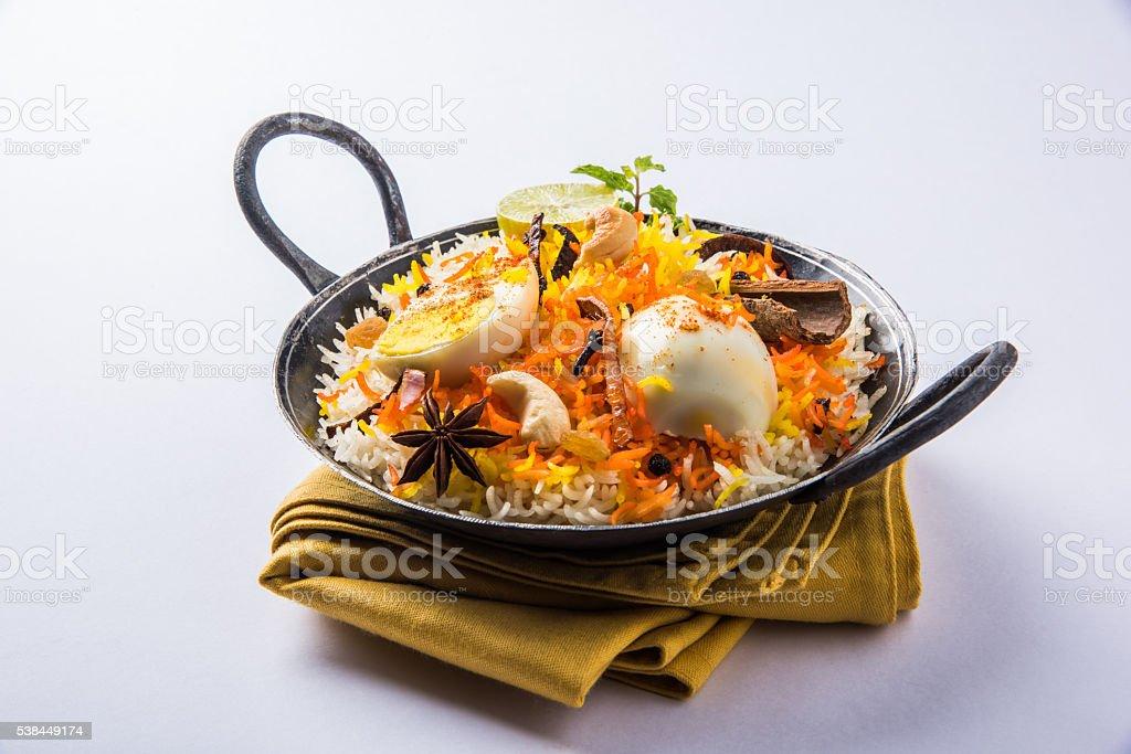 egg biryani or anda biryani using basmati rice and spices stock photo