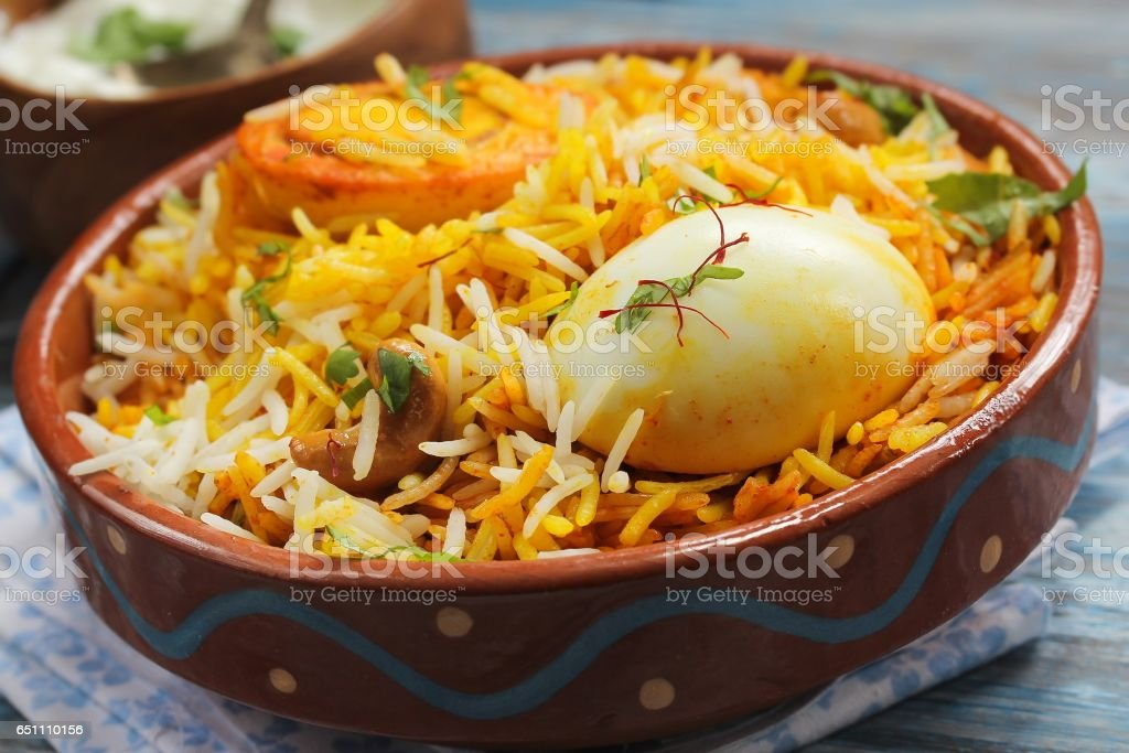 Egg Biryani served with yogurt dip on a clay pot, selective focus stock photo