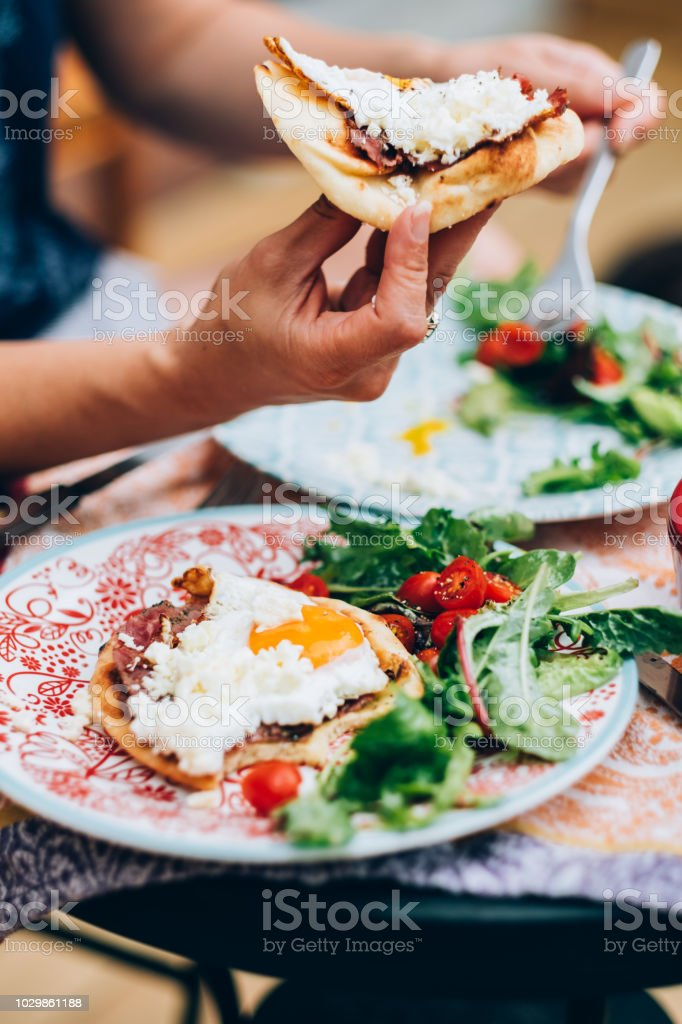 Egg breakfast in the hand stock photo