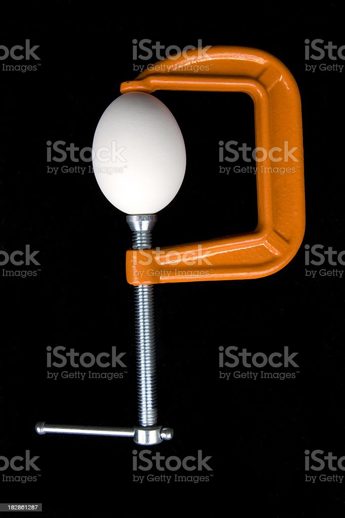 Egg Clamped Under Pressure stock photo
