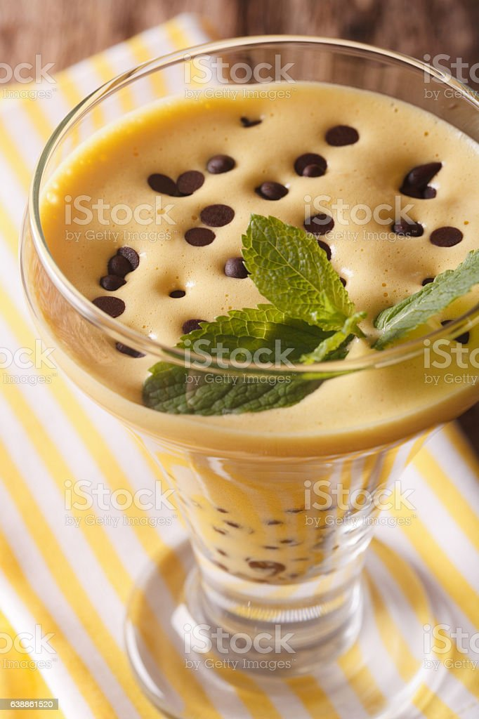 egg cream sabayon with chocolate drops close up. vertical stock photo