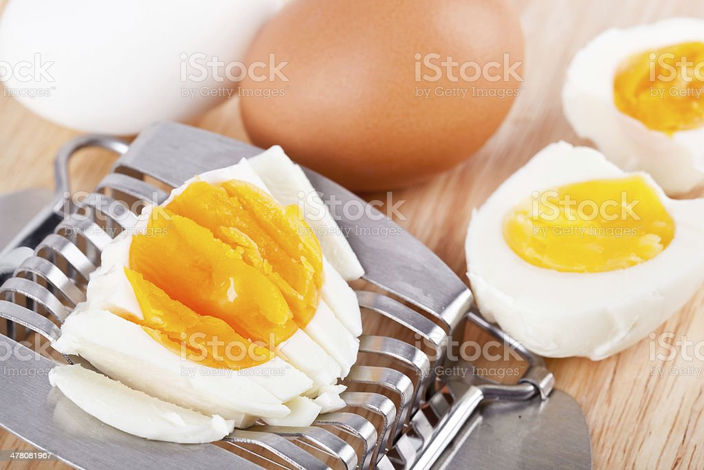 Egg cutter and cutted eggs on table royalty-free stock photo