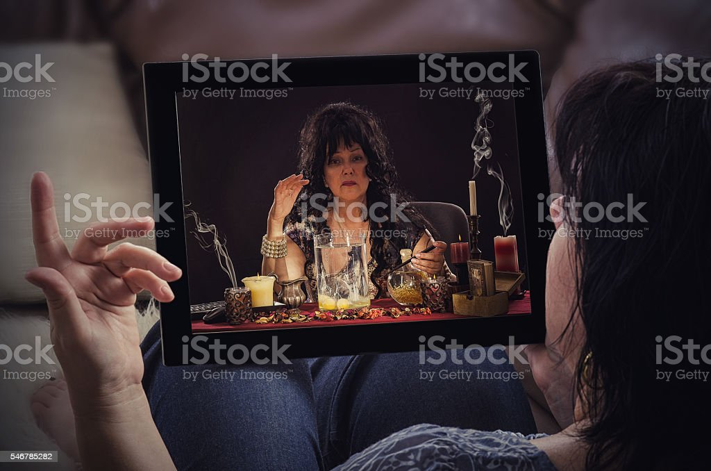 Egg divination with psychic on sofa stock photo