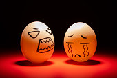 istock egg faces of an angry one blaming a crying one highlighted in dark 1279915206