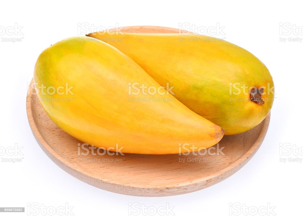 Egg fruit, Canistel, Yellow Sapote (Pouteria campechiana (Kunth) Baehni) in wood dish isolated on white stock photo