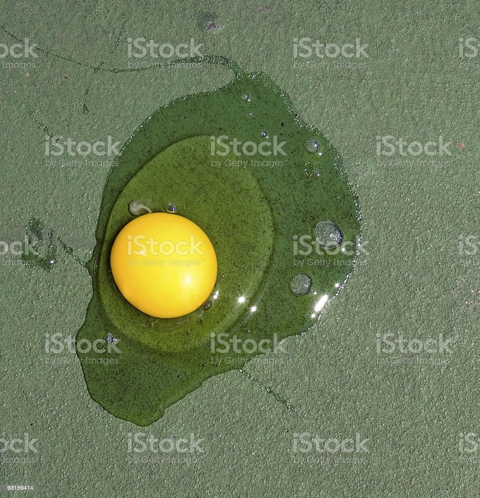 Egg frying on hot tennis court royalty-free stock photo