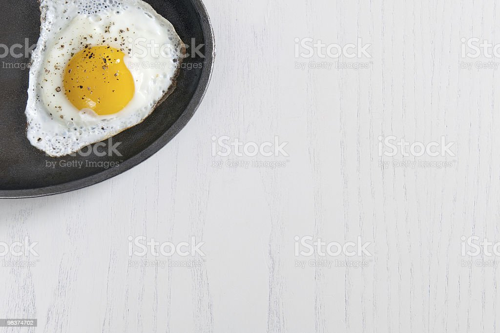 egg in a pan royalty-free stock photo