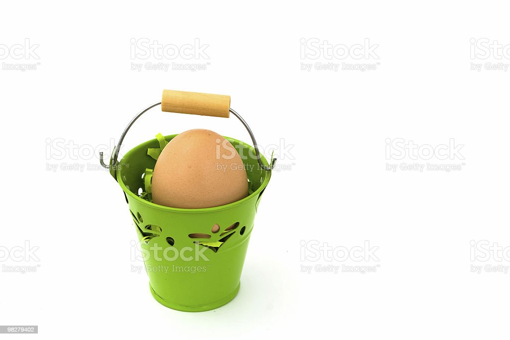 Egg in green basket royalty-free stock photo