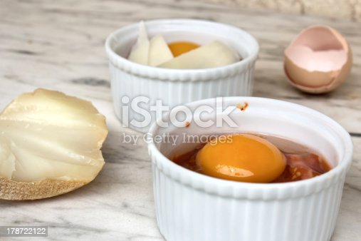 Egg in ramekin with tomato souce and chorizo not cooked