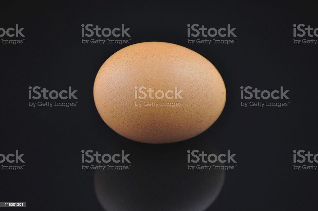 Egg isolated on black stock photo