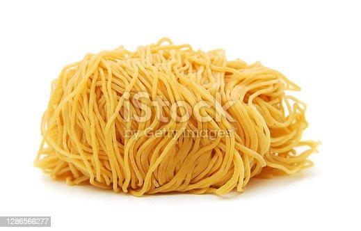 Egg noodles, isolated on white background.