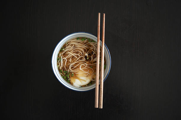 Egg noodles with soy sauce and chopped green onion stock photo