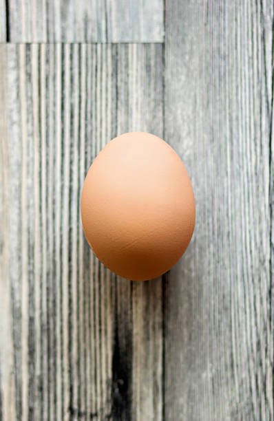 Egg on a wooden surface stock photo