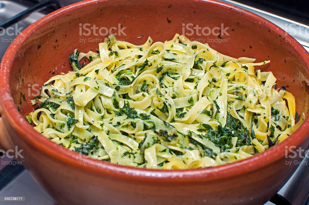 Egg pasta with spinach stock photo