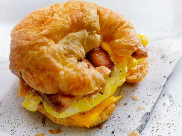 Egg, Sausage and Cheese Breakfast Croissant stock photo
